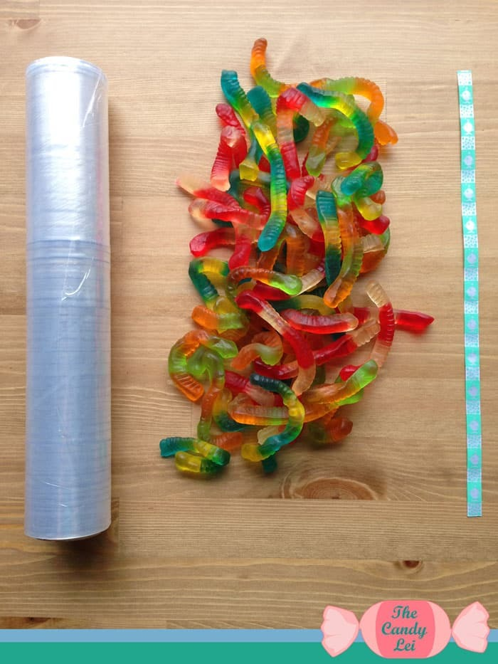Materials to make a gummy worm candy lei
