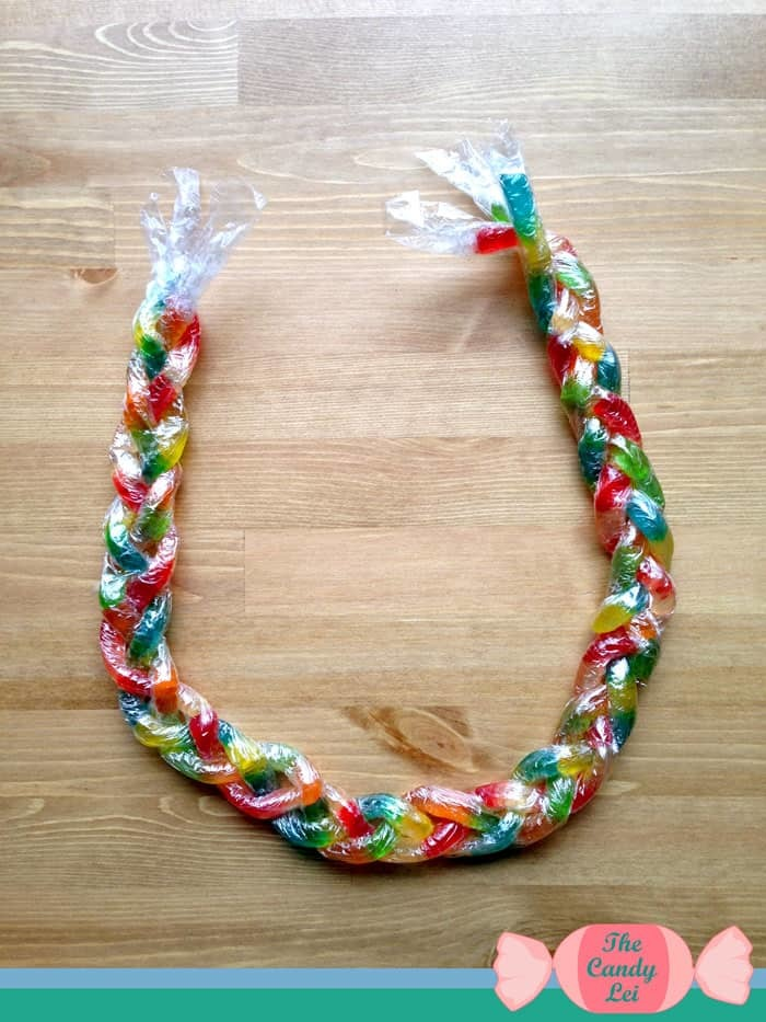 Nearly completed gummy worm lei