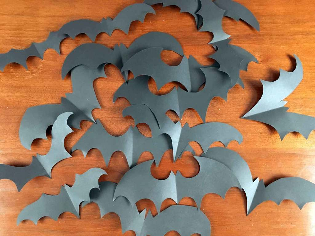 Cut out 20 to 30 paper bats to use as Halloween decor