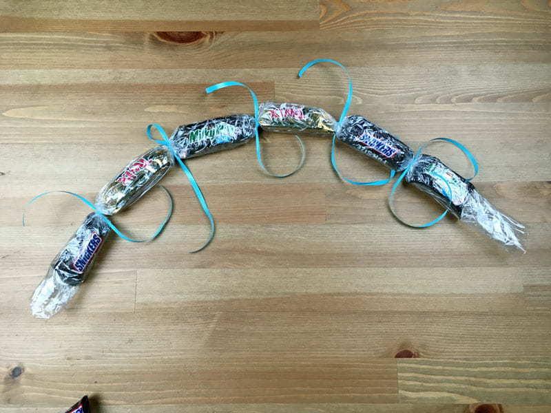 Tie Ribbon around the saran wrap for your lei