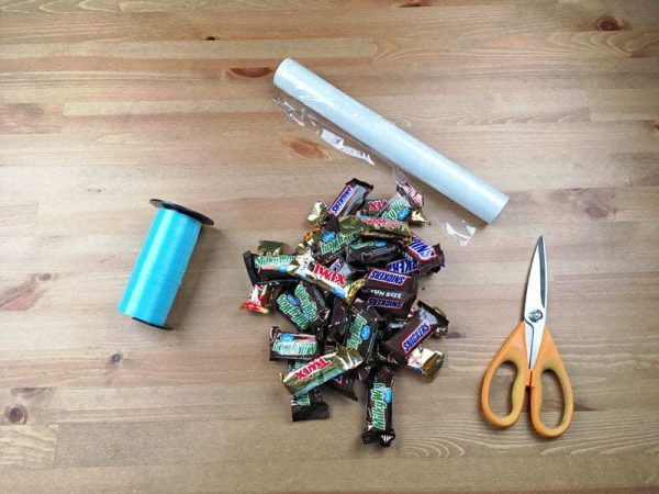 Supplies needed to make a candy graduation lei