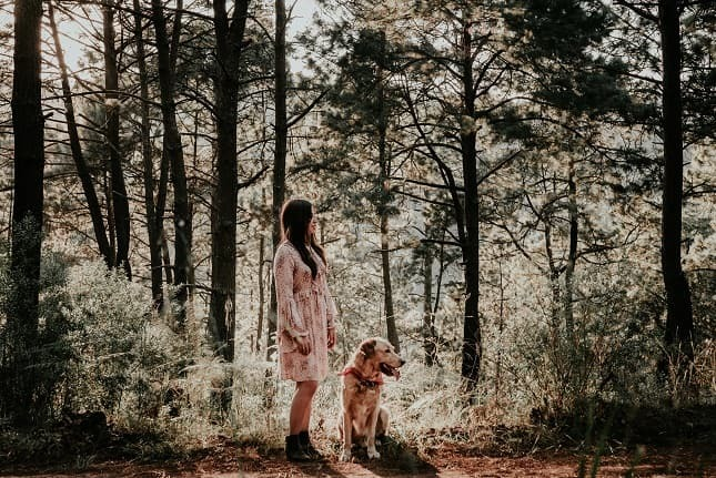 Forest pic of a girl and her dog. Nice senior picture idea