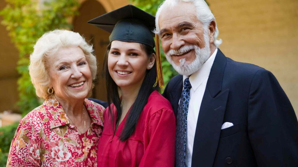 High school girl with her grandparents at graduation
