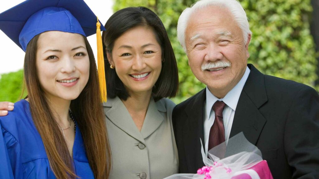 High school graduate with her grandparents